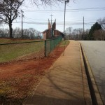 Photo Caption: Today the school principal approached me in the parking lot and mentioned she would like wildflowers in front of the school as well. This strip between the sidewalk and ball field would be ideal.